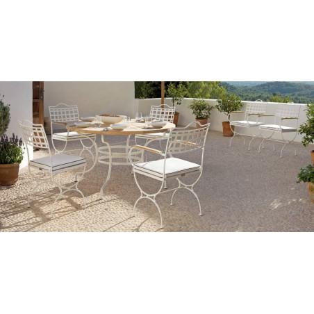 Round outdoor dining table Capri by Manutti - White frame, teak top