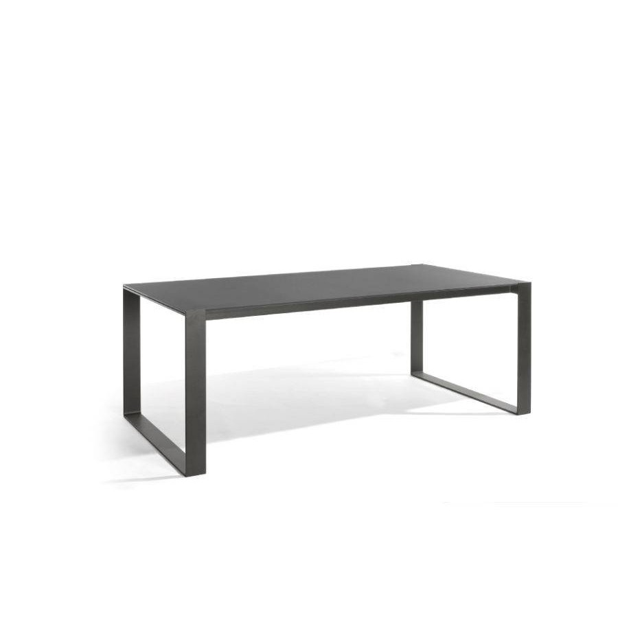 Rectangular outdoor dining table Prato by Manutti - Lava frame, black glass top